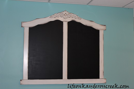 large chalkboard with logo and rs