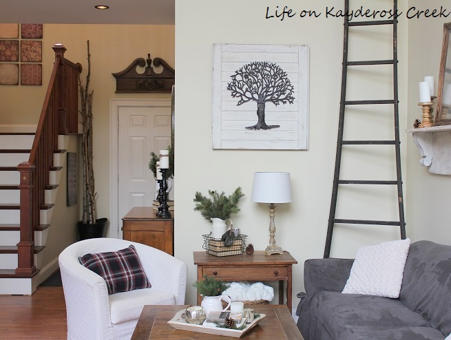 Metal decorative tree turned fixer upper inspired DIY wall art