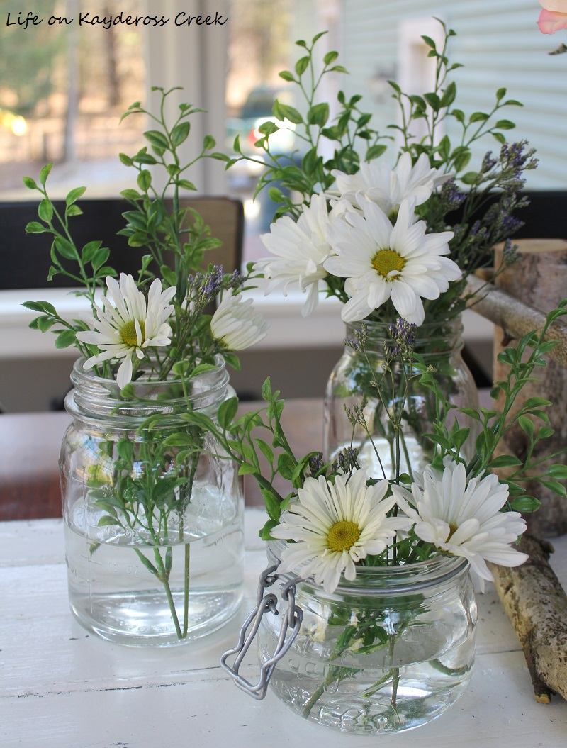 Glass jar centerpiece with an adirondack twist life on