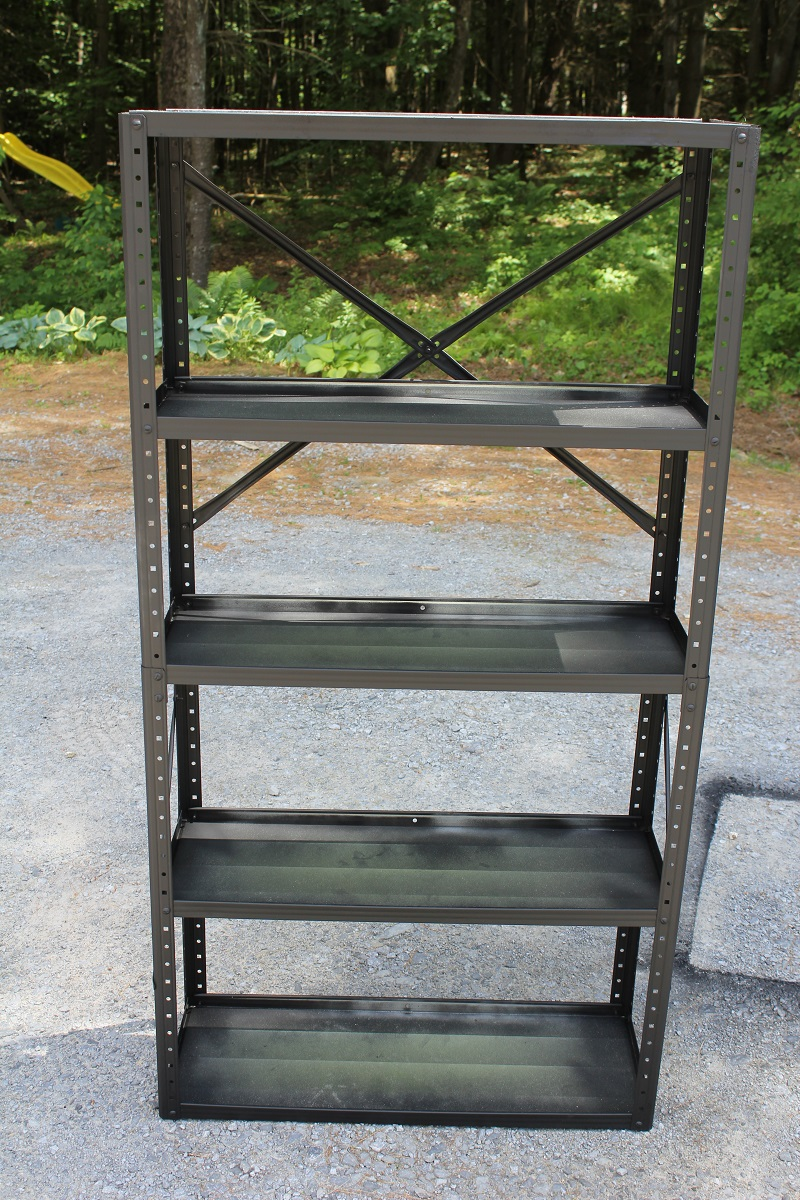 A Garage Sale find Metal Shelf turned Pottery Barn Industrial Bookshelf knockoff. Find out how at Life on Kaydeross Creek