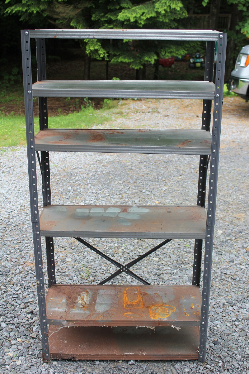 Garage sale Metal Shelf before - see how to turn it into a Pottery Barn Industrial Bookshelf knockoff at Life on Kaydeross Creek