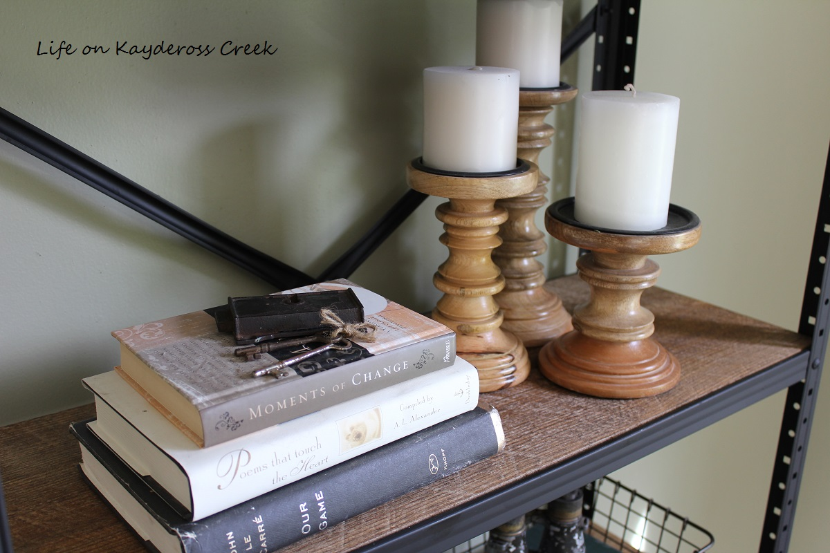 How to style a Pottery Barn inspired Industrial Bookshelf made from a garage sale find. See how at Life on Kaydeross Creek