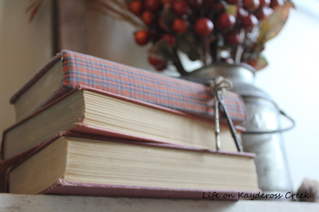 5 Easy Ways to upcycle and decorate with vintage books - books covered in fabric - Life on Kaydeross Creek