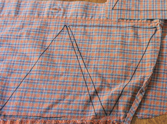 Fall DIY Project - Pieces of an old plaid shirt are used to create a Fall pennant. What a great way to utilize and unworn shirt and create cute and unique fall decor. Budget friendly too!