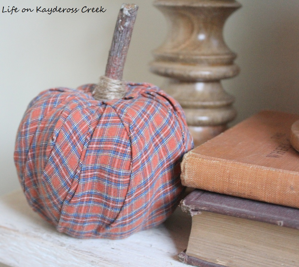 Fall DIY Project - Pumpkin made from a plaid shirt. A great way to use an old shirt and create cute fall decor on a budget.