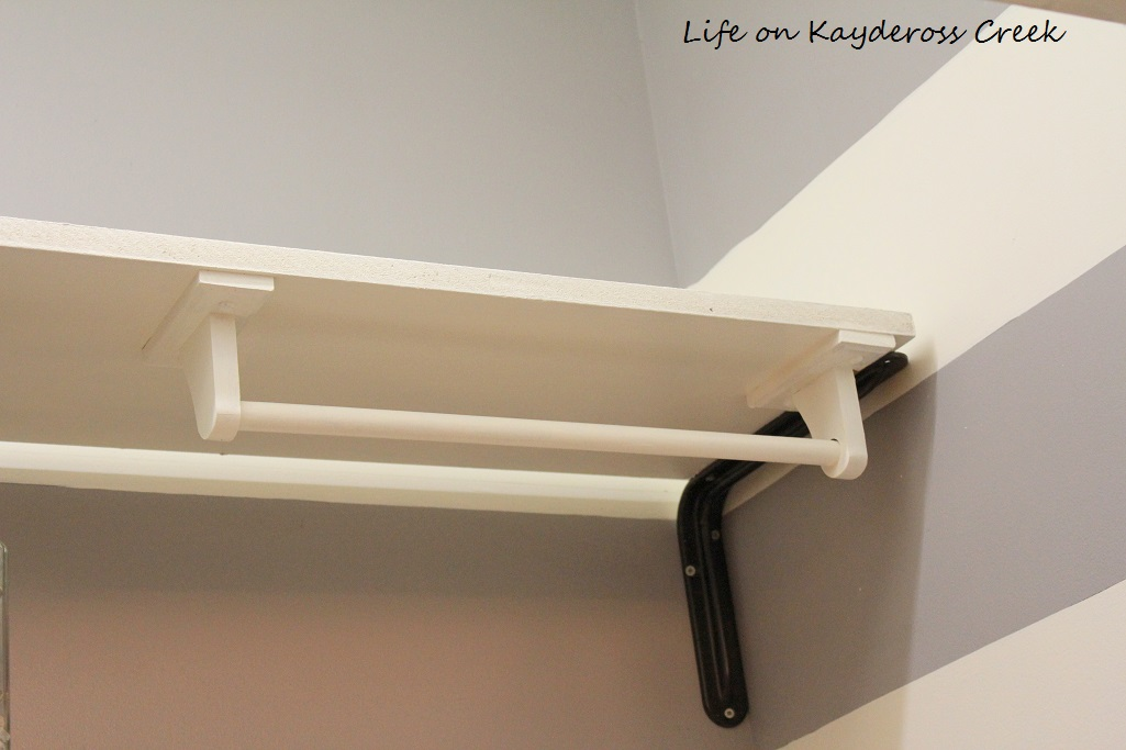 Laundry Room Organization for Under $100 - Life on Kaydeross Creek - DIY Hanging space using an inexpensive towel bar