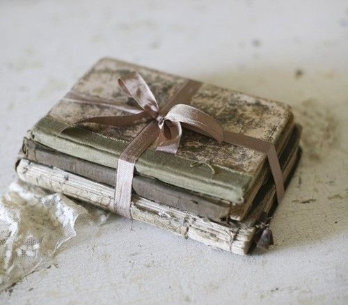 Books tied with ribbon - 5 easy and inexpensive ways to upcycle and decorate with books - Life on Kaydeross Creek