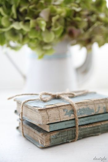 Books tied with twine - 5 easy ways to upcycle and decorate with vintage books - Life on Kaydeross Creek