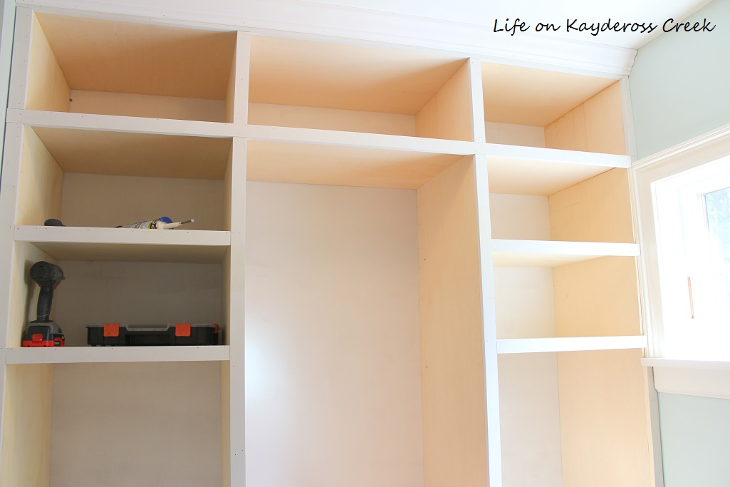 Master Bedroom Closet Makeover - built in cubbies with the trim added - Life on Kaydeross Creek