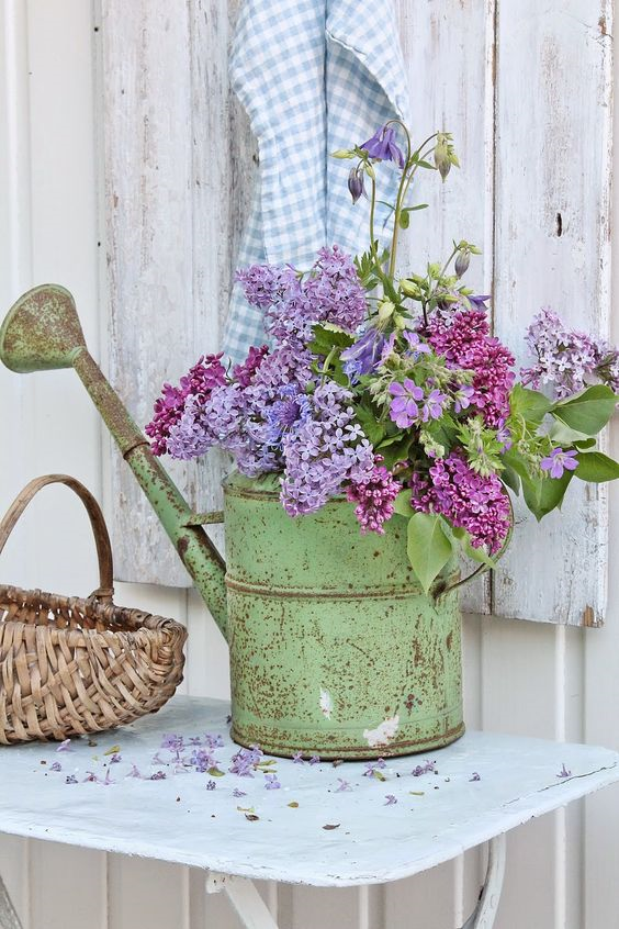 Creative ways to display flowers - green watering can - Life on Kaydeross Creek