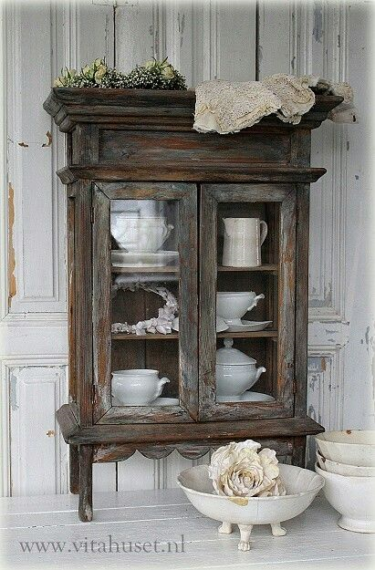 30 Farmhouse Furniture Makeovers - antique stained curio cabinet - Life on Kaydeross Creek