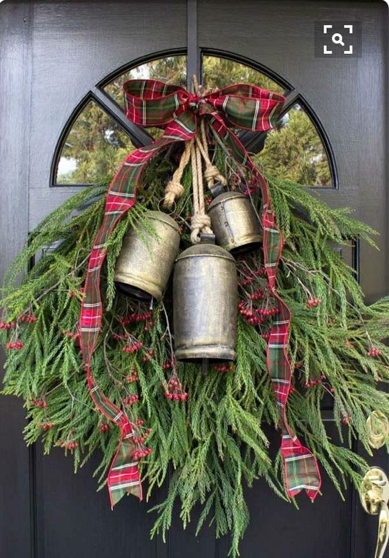 20 Alternatives to Wreaths for Fall and Winter - greenery swag with bells - Life on Kaydeross Creek