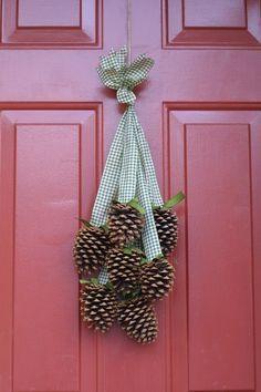 20 Alternatives to Wreaths for Fall and Winter - pinecone swag with checkered ribbon - Life on Kaydeross Creek