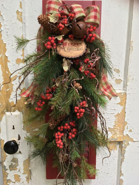 20 Alternatives to Wreaths for Fall or Winter - rustic swag on shutter - Life on Kaydeross Creek