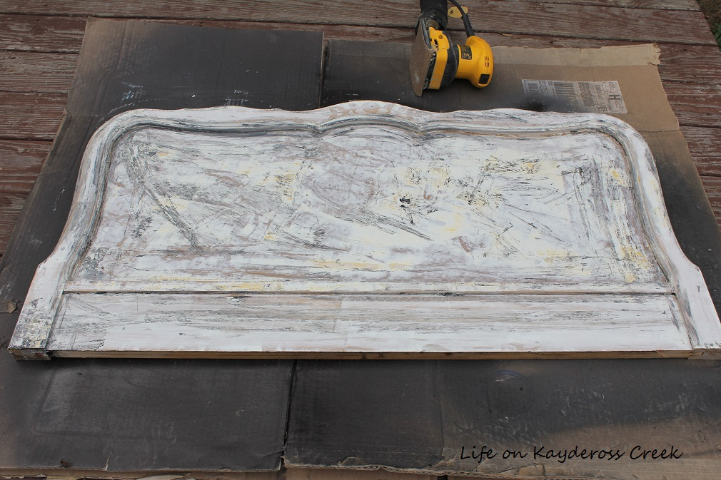 How to Create a Unique Farmhouse Chalkboard From a Twin Headboard - Paint removed and ready to sand - Life on Kaydeross Creek