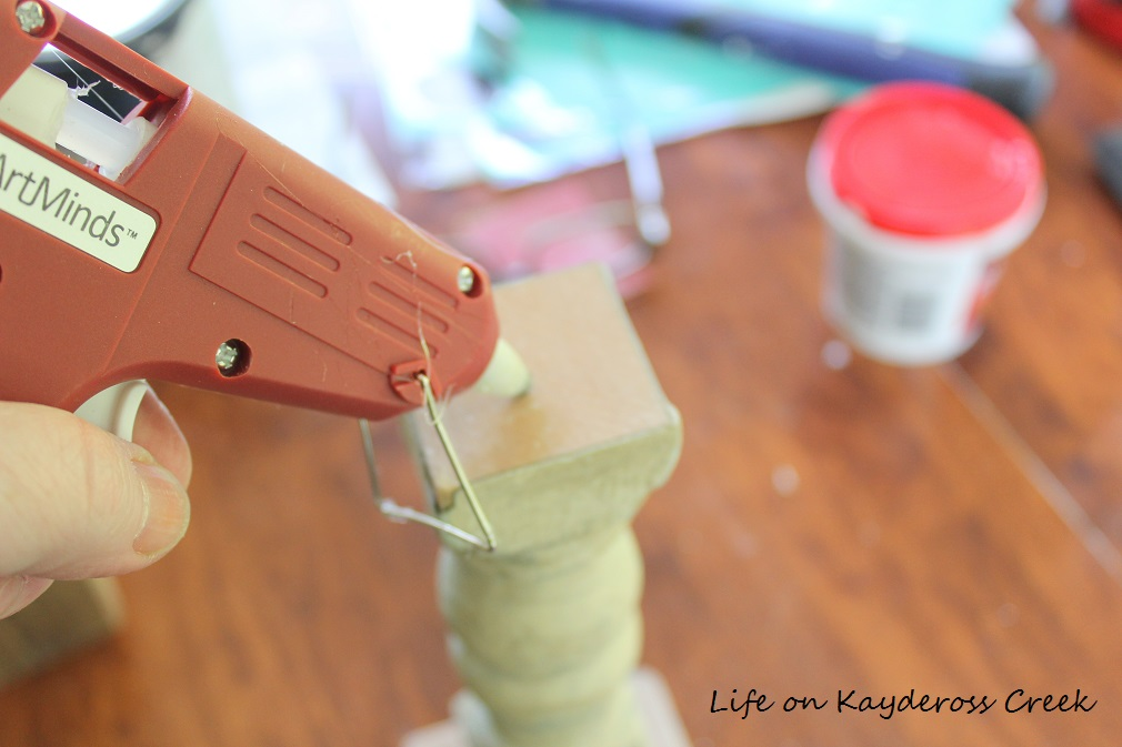 How to make candlestick holders from old spindles - attaching the pieces with hot glue - from Life on Kaydeross Creek