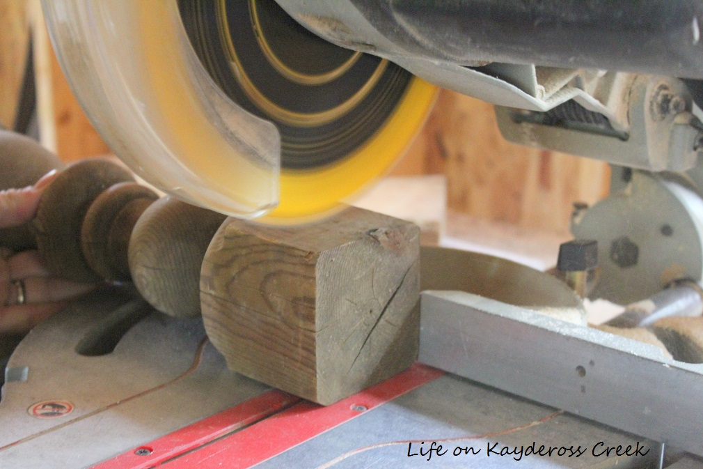 How to make candlestick holders from old spindles and scrap wood - cutting the piece - farmhouse - from Life on Kaydeross Creek